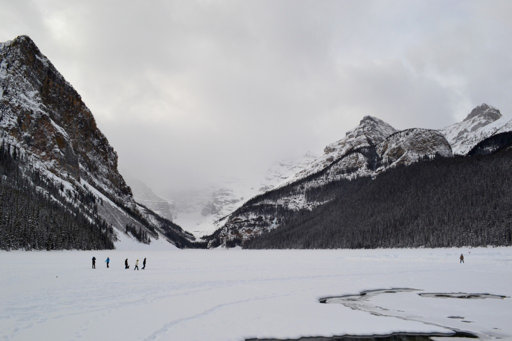 Lake Louise, covered in snow and brave ice-walking families